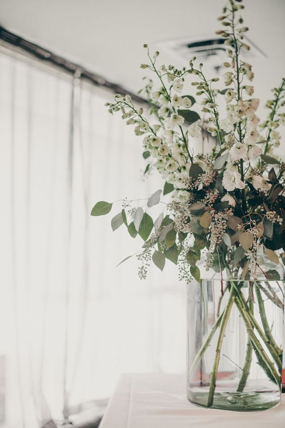 eucalyptus arrangement, photo by Christine Lim http://ruffledblog.com/glam-toronto-hotel-wedding #flowers #floral