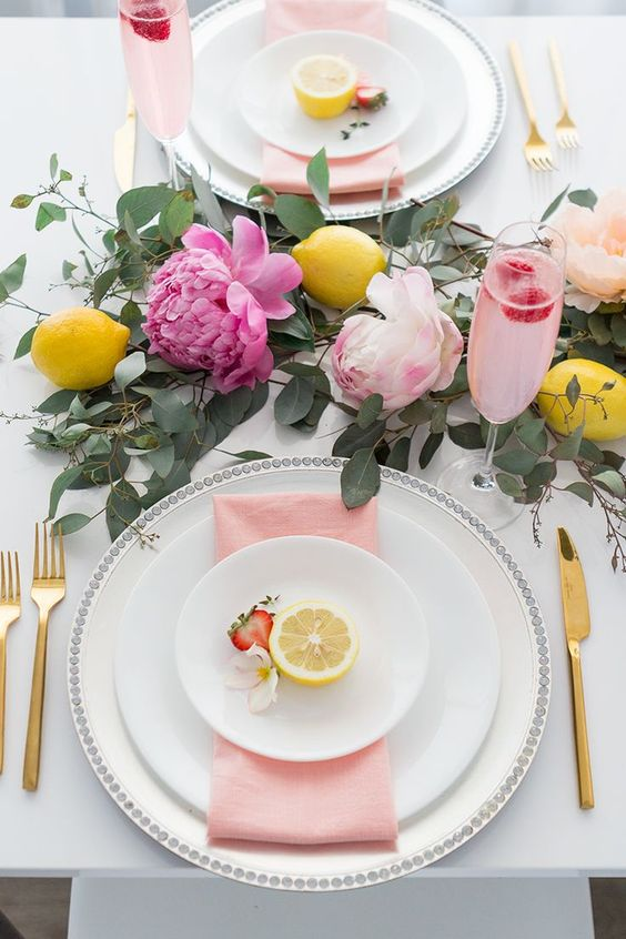 Sweet summer brunch party filled with peonies, lemons and pretty dresses. Details include: Eucalyptus garland, pink napkins, gold cutlery & silver chargers.