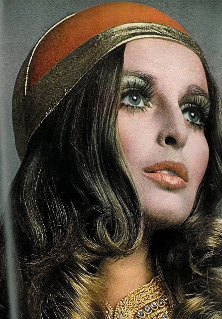 Blue eye shadow, defined lashes, and a soft coral lip were popular in the 1970's. It was a part of the 1970's boho, hippie street style.