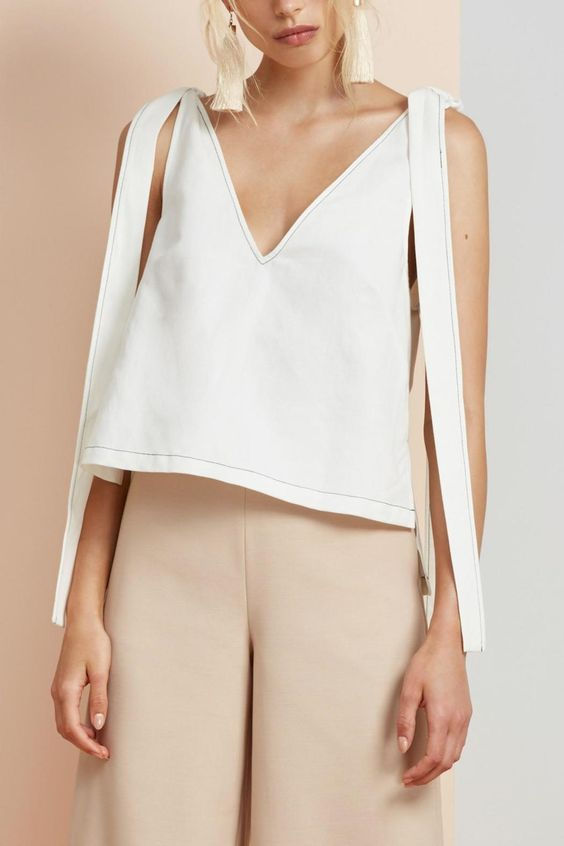 With tie-fastened shoulders and an on-trend v-neckline, the Finders Keepers Pablo Top is a fresh take on a classic crop top. The contrast stitching lends to the fashion forward look. - Length: Front: 44cm; Back: 50cm - Boxy fit - Dense linen and cotton blend fabric - Off-white hue - V-neckline - Tie shoulder fastening - Contrast stitching - Stepped hemline Cold hand wash. Warm iron inside out. Length: Front: 44cm; Back: 50cm   Pablo Top  by Finders Keepers. Clothing - Tops - Short Sleeve…