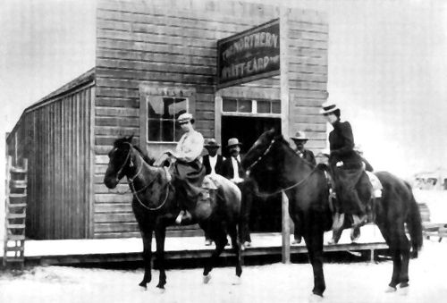 Wyatt Earp's saloon in Tonapah, Nevada. The woman on the left is thought to have been Josie Earp, photo 1902.