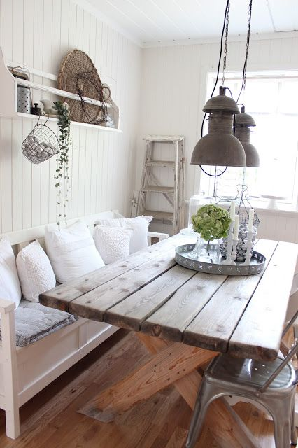 Wood table, white accents, vintage industrial fixtures, ladder
