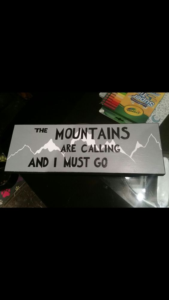 Homemade sign 'The mountains are calling and I must go' house signs