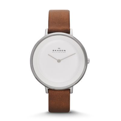Our Ditte Women's Leather Watch features a monochromatic dial with raised circular waves inspired by the wind-carved sands near Skagen. The minimalist matte dial features two-hand movement and is encased in a generous 36.5-mm polished stainless steel case. We added a soft leather band with traditional buckle closure and pin attachments to give this dress watch for women a versatile look that works in business as well as casual realms.