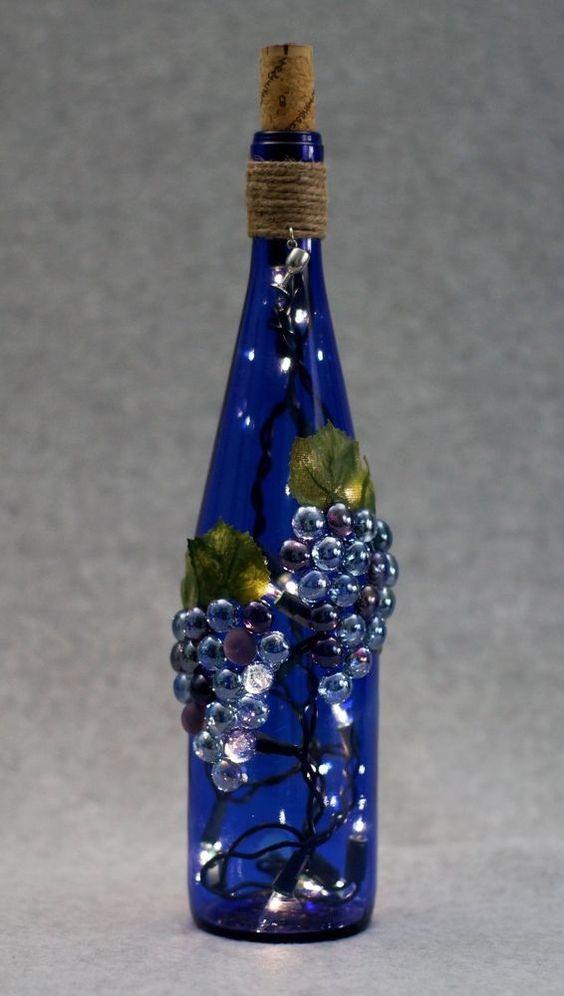 Gardens cobalt blue and wine on pinterest for Wine bottle light ideas
