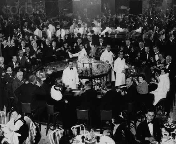 """""""Celebrating the End of Prohibition""""  Men and women crowd a fancy club on Park Avenue to celebrate the end of Prohibition. (1933)"""
