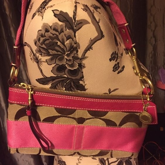 Authentic Coach bag Coach bag tan with pink ribbon trim. Pink leather trim and zipper pulls. Handle is pink canvas and pink leather all metal is gold. Used one time. One small mark in ribbon. See picture. Coach Bags Mini Bags