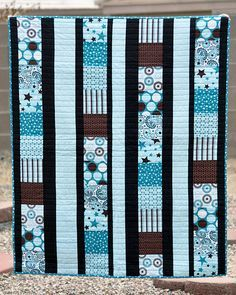 """I love the combo of blues and browns - 4"""" squares for crib, I will use 6"""" squares for a large quilt"""