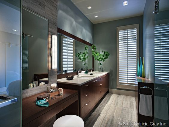 In a bathroom, good lighting for putting on make-up should come evenly from either side of the mirror so shadows are not cast on the face. The rest of the room needs to be lit evenly from overhead, but be careful of placing recessed pot lights that are directly over your head when standing in front of a mirror or else you will have shadows under your eyes.