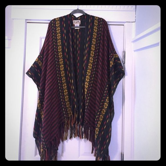 Amazing embroidered Free People Poncho LOVE this piece!!  Amazing embroidered poncho.  This piece hits pretty long (knee length).  The embroidery is beautiful.  Fringe edging.  One of my favorite FP ponchos! Free People Sweaters Shrugs & Ponchos
