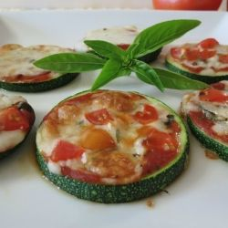 Grilled Zucchini Mini Pizzas - a healthy alternative to traditional pizza made with zucchini, pizza sauce, fresh basil, mozzarella cheese and cherry toma