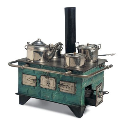 European turquoise tinplate stove...for dolls.  Oh, I just fell in love.