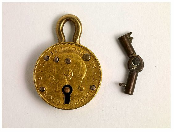 A miniature padlock made from half a sovereign, George Spencer.