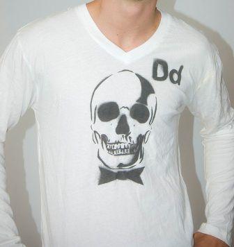 DEAD MANS PARTY  -100 % cotton long sleeve v neck   -White black print  PRICE: $30.00    http://www.druedun.com/store/44/28/DEAD-MANS-PARTY.html