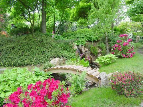 Garden Great Arch Wooden Bridge Over Small Rocky River Ideas: