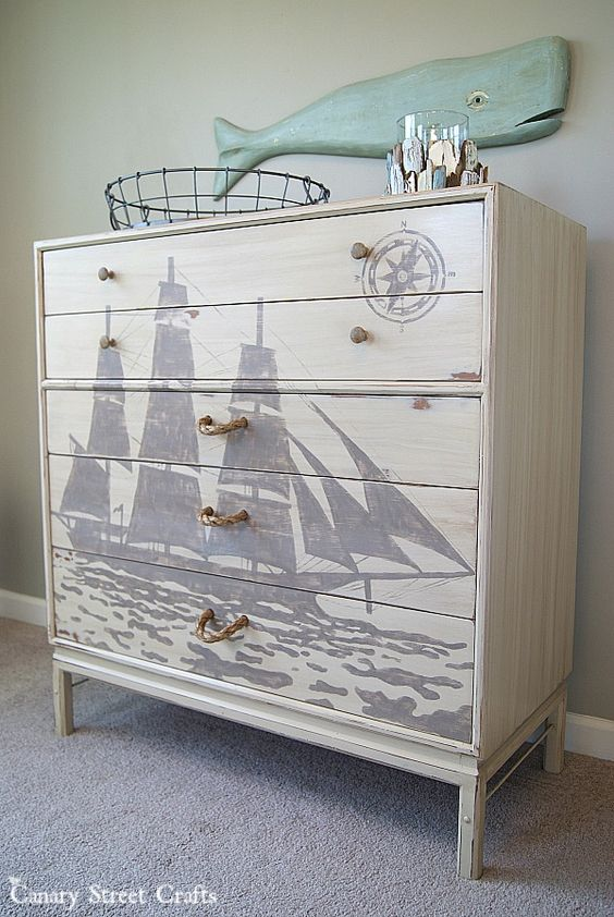 A painted ship silhouette and DIY rope pulls on a nautical dresser makeover - by Canary Street Crafts: