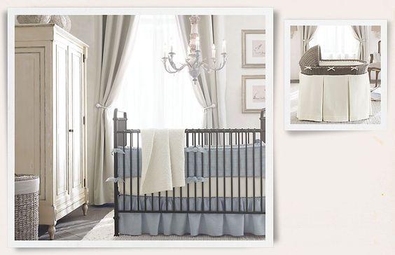 Blue bedding against pale grey walls and dark grey floors