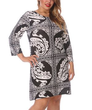Show off a frock with a little pizzazz! This shift dress combines a flirty length with an eye-catching abstract print.   Size note: This item runs small. White Mark recommends ordering one size up.