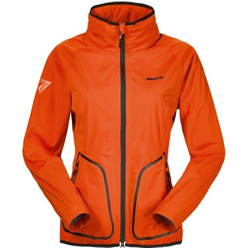 Musto Ladies ZP 176 Warm Up Orange Jacket - A waterproof, windproof and breathable piece with 4-way stretch fabric for freedom of movement, an ergonomic sports fit with tapered draft excluding sleeves and a roll away hood. Buy from MillbryHill.co.uk today!