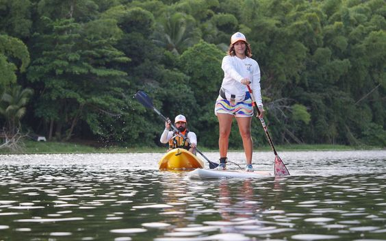 "Go paddle-boarding in Gurabo, Puerto Rico's non-touristy ""countryside"": Couples that gravitate towards a secluded, laid-back vibe should visit the remote area of Gurabo, Puerto Rico, where verdant hillsides surround the peaceful Carraizo Lake. The destination is only a 30-minute drive from the busy capital of San Juan. Here, Paddle Paradise hosts kayaking, paddle-boarding, and zip-line excursions for nature lovers.:"