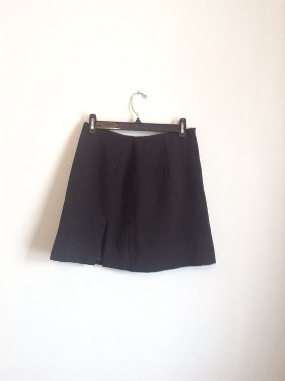 Vintage 90s black mini skirt with side slit!  Ladies size medium (9)  100% polyester  Measurements Lying Flat:  Waist: 14 inches Length: 17 inches