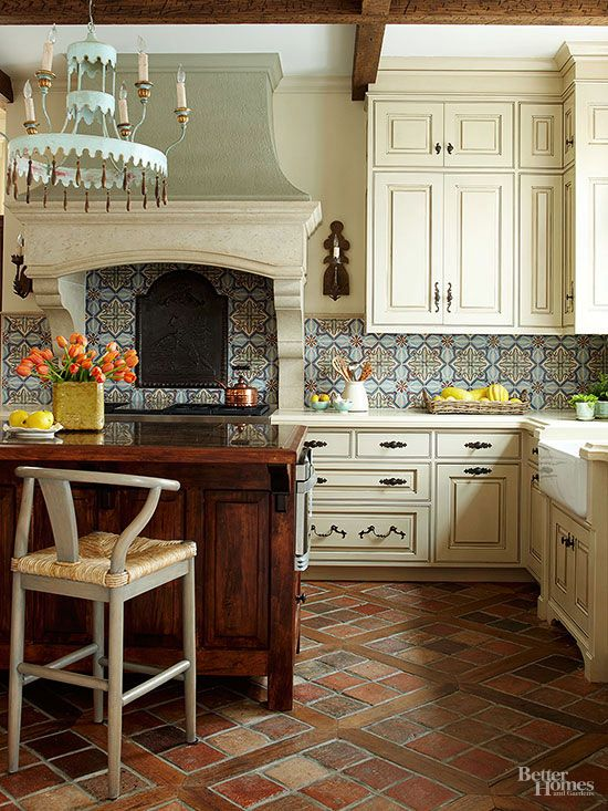 Tuscan kitchens are renowned for putting ordinary materials on display. A humble terra-cotta tile floor is elevated into a stunning architectural feature when laid on the bias and bisected by salvaged wood.: