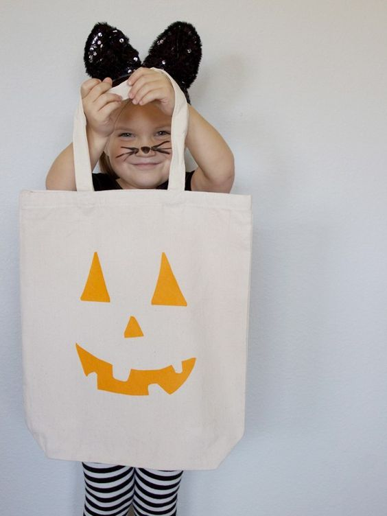 Use this free printable template to make a pumpkin face Halloween trick or treat tote!