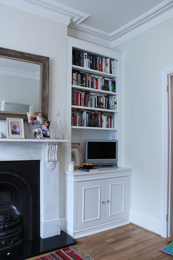 built in bookcase can double as computer desk if you open lower cabinets