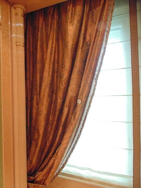 Lot 328 - A set of four asymmetrical curtains (makes 2 pairs) of bronze gold curtains supplied by Jacquard