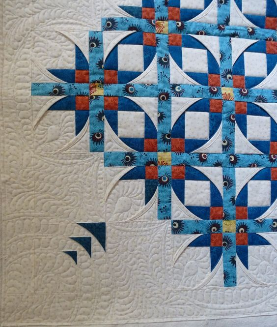 Mexican Stars quilt, design by Annette Ornelas.  Quilting by Eagles' Wings Quilts (Ontario).