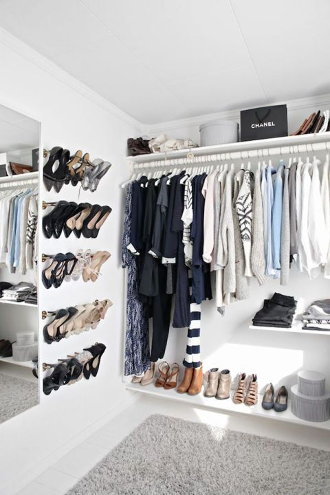 Utilizing towel bars as shoe racks makes for a simple yet chic way to show off your best footwear. When styled with streamlined shelves, it adds the perfect amount of minimalism to your closet.