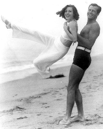 Movie star of the 30's & 40's Joel McCrea & his wife, Frances Dee having fun on a California Beach: