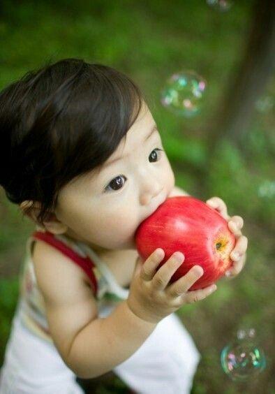 Cute Baby eating apple. ♥ So very cute and juicy