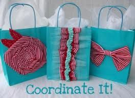 Turn plain gift bags into beautiful gift bags by adding bows,ruffles and flower applique.