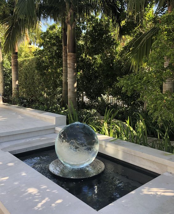 Some of my clients chose to forego the dish on the Aqualens and make their own pool to recirculate the water! Purchase yours today: www.allisonarmour.com #spherefountain #gardenart #gardensculpture #landscapedesign #modernwaterfeature #modernfountain #contemporaryfountain #contemporarywaterfeature #naples #florida #ballfountain