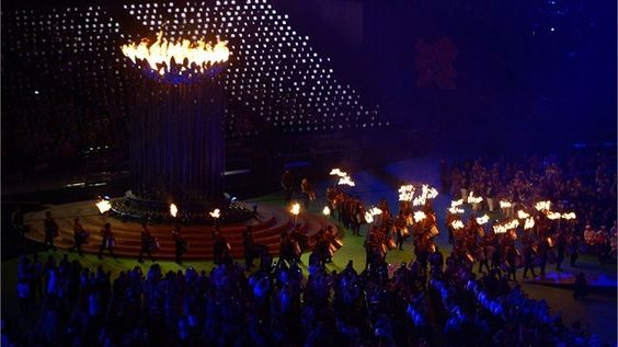 The Paralympic Flame burns in the Cauldron as performers carry torchesthrough the Stadium during the Closing Ceremony.