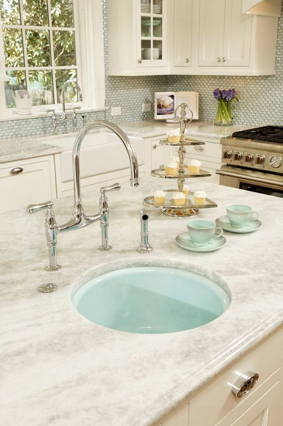 turquoise sink in the island