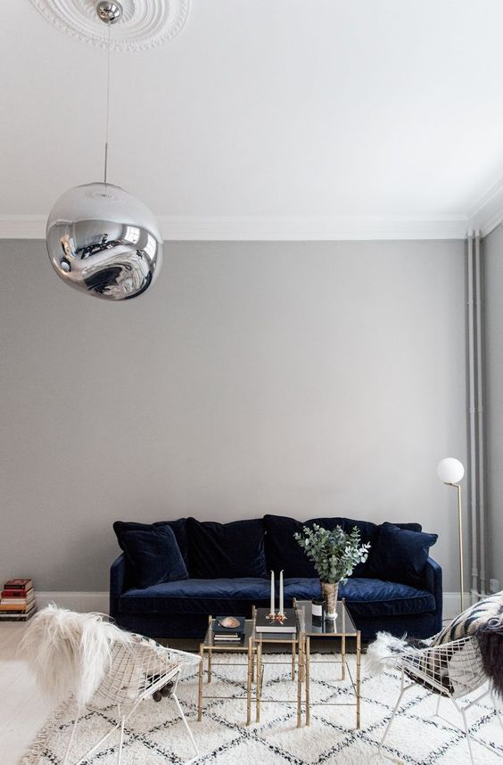 Scandinavian living room with blue velvet sofa