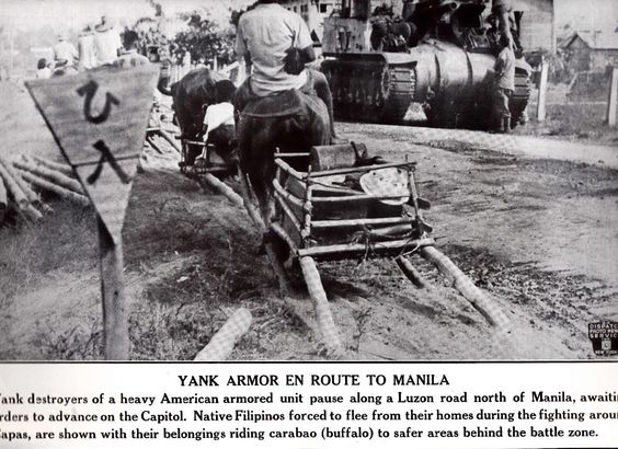 US tank destroyers paused along a Luzon Road (probably in Pampanga) on way to Manila, PI. WWII Dispatch Photo News Service