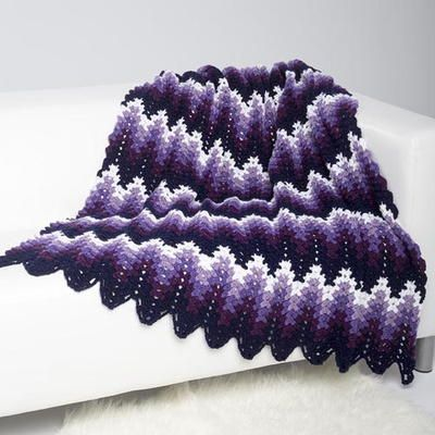Perfectly Purple Ripple Throw - This stunning crochet afghan pattern would look lovely draped over your couch. It's the perfect blanket for winter.