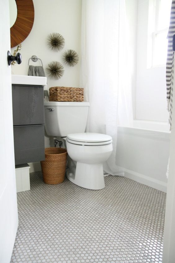 penny tile floor, subway tile shower, neutrals, toilet seat with flip down kid seat (!)