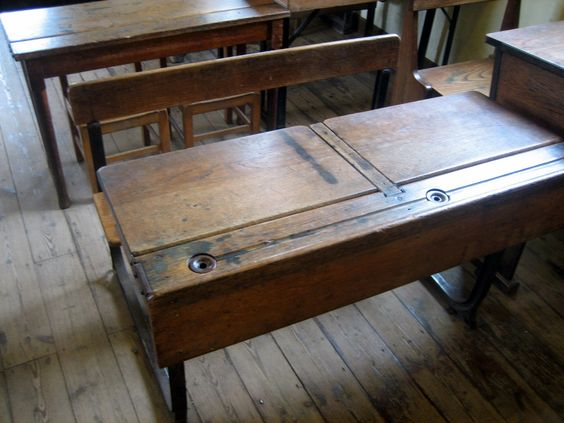 school desks with ink wells - I sat at desks like this in primary school - but did not write with ink! (not quite that old) ***ditto***