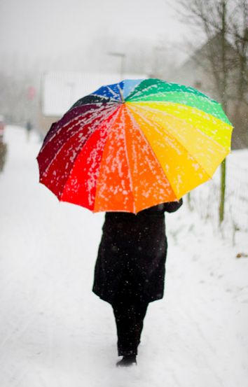 Image result for person walking in snow with a coloured umbrella