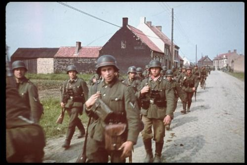 May 28, 1940: Belgium surrenders unconditionally to Germany. Photo: German infantry entering Belgium, May, 1940 (Hugo Jaeger/Time Life Pictures)