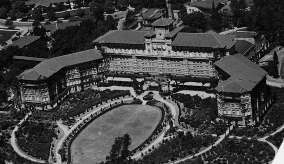 (ca. 1920)* - Aerial view of the Huntington Hotel in Pasadena. View also shows the hotel's immense oval shaped lawn and the many roads in front of the building.  Water and Power Associates