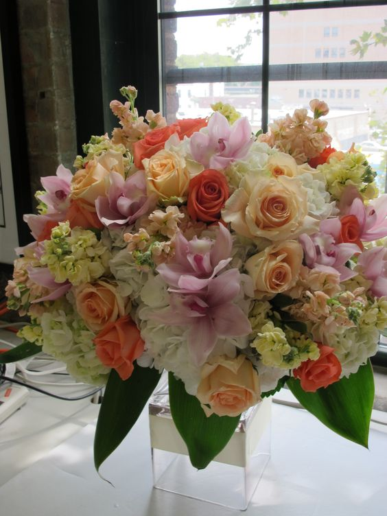 love the combination of peach, pink and creams with a touch of coral in this centerpiece we did