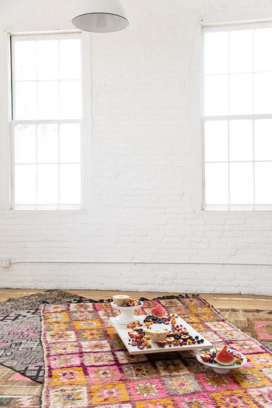 indoor picnic with fresh cut fruit on rugs from abc carpet and home / sfgirlbybay