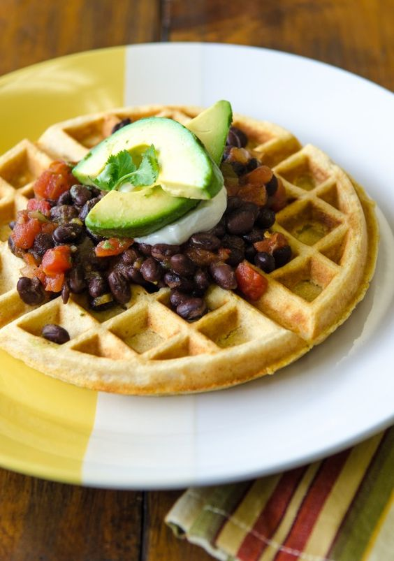 Cornmeal Waffles with Black Beans | Bob's Red Mill- I will totally admit that I made this cheap and easy by making waffles from Jiff Corn Muffin Mix and topping them with canned chili- I will also say though, that it was the best damn thing I ever ate and will profusely thank Bob Red Mill for providing me with this amazing idea
