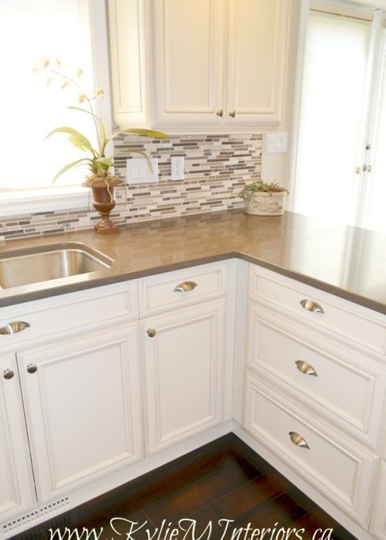 Oak kitchen remodel painted cream cabinets and quartz for Cost to update kitchen cabinets and countertops
