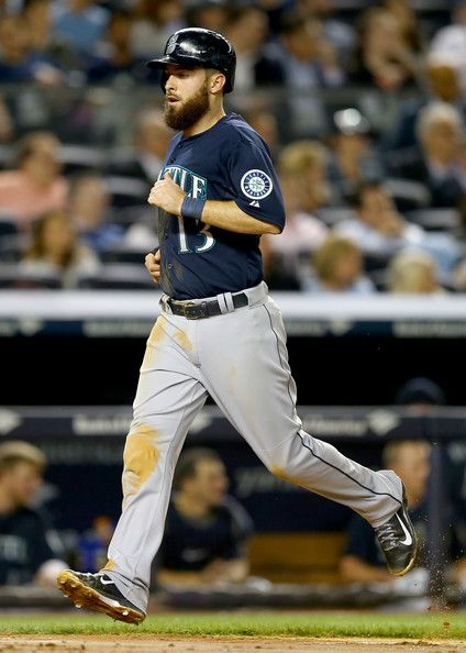 Dustin Ackley #13 of the Seattle Mariners scores in the fourth inning against the New York Yankees on May 1, 2014 at Yankee Stadium in the B...